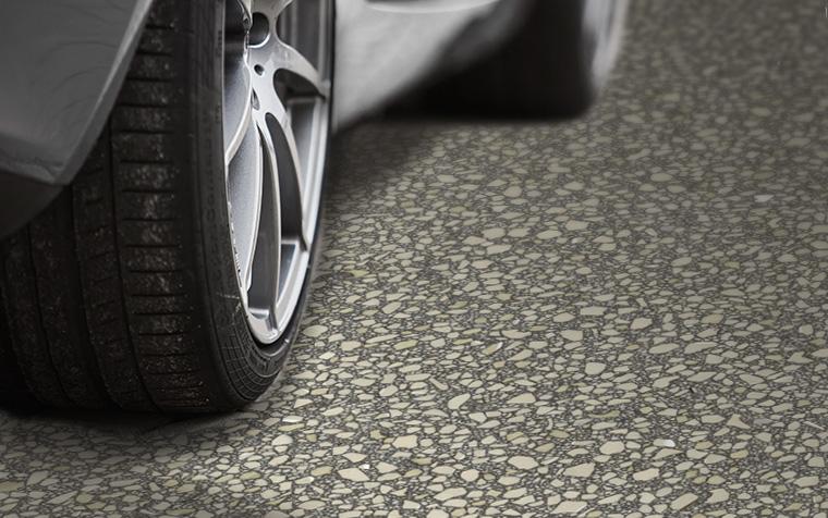Car tire on garage floor